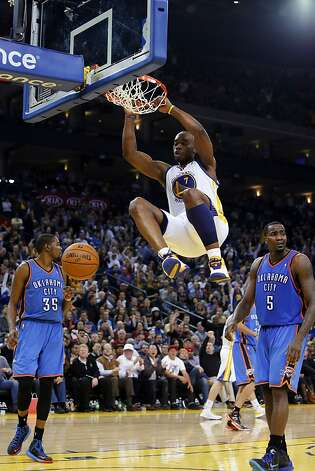 Carl Landry dunks the ball in the second half. The Golden State Warriors played the Oklahoma City Thunder at Oracle Arena in Oakland, Calif., on Wednesday, January 23, 2013. Photo: Carlos Avila Gonzalez, The Chronicle