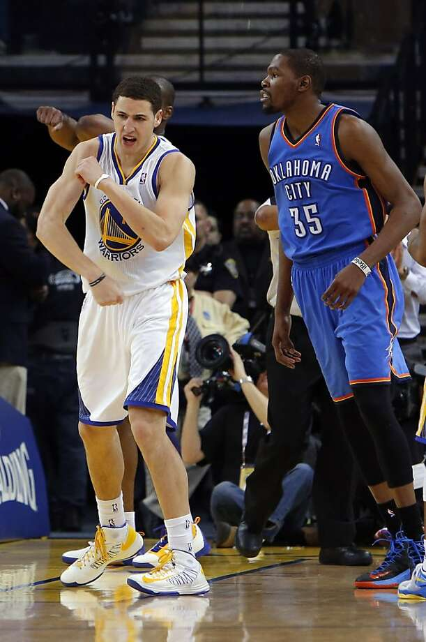 Klay Thompson reacts to a traveling call against Kevin Durant in the second half. The Golden State Warriors played the Oklahoma City Thunder at Oracle Arena in Oakland, Calif., on Wednesday, January 23, 2013. Photo: Carlos Avila Gonzalez, The Chronicle