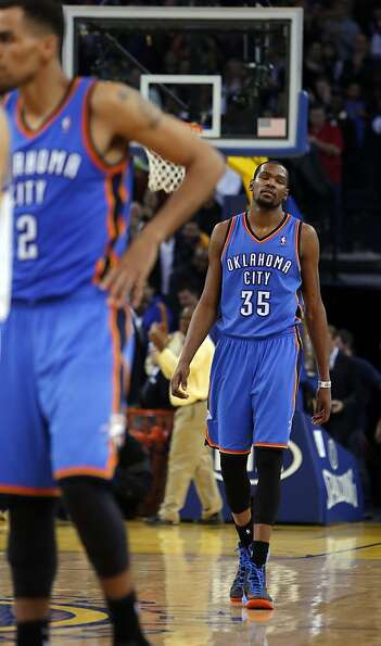 Kevin Durant reacts to having an inbound pass stolen in the final seconds of the second half. The Go