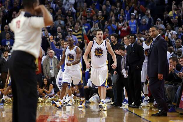 The Warriors bench celebrates in the final seconds of the second half. The Golden State Warriors played the Oklahoma City Thunder at Oracle Arena in Oakland, Calif., on Wednesday, January 23, 2013. Photo: Carlos Avila Gonzalez, The Chronicle