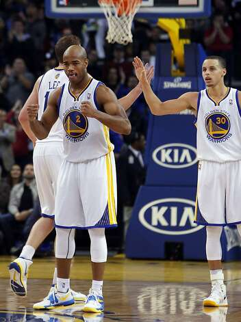 Jarrett Jack, front, David Lee, rear, and Stephen Curry, right celebrate a play in the second half. The Golden State Warriors played the Oklahoma City Thunder at Oracle Arena in Oakland, Calif., on Wednesday, January 23, 2013. Photo: Carlos Avila Gonzalez, The Chronicle