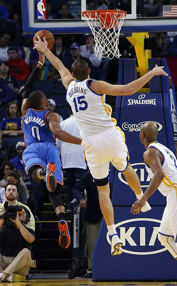 Andris Biedrins blocks a shot by Russell Westbrook in the first half. The Golden State Warriors played the Oklahoma City Thunder at Oracle Arena in Oakland, Calif., on Wednesday, January 23, 2013. Photo: Carlos Avila Gonzalez, The Chronicle