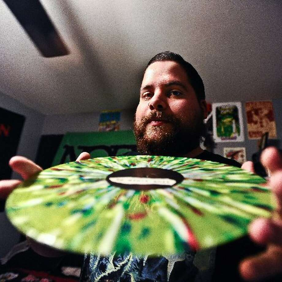 Welcoming us into his home on Tuesday, January 15, 2013, Jordan Payne shows us his NOFX - HOFX album. Each one of these pieces of vinyl have a different design than the other 7000+. Randy Edwards/cat5
