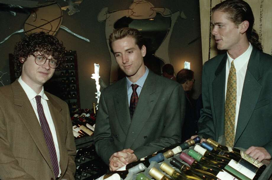 Oct. 29, 1992: Looking comfortable in his power suit at the PlumpJack opening party, a 24-year-old Newsom dreams about tidal power as an alternative energy. Newsom appears to have highlights in his hair. (Sun-In? Is that natural?) Peter Getty is on the left, Billy Getty on the right. Photo: Steve Castillo, The Chronicle / ONLINE_YES