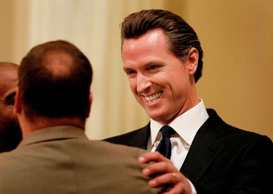 Jan. 18, 2012: Lt. Governor and former San Francisco mayor Gavin Newsom greets a colleague after Gov. Jerry Brown's state of the state speech. Photo: Brant Ward, The Chronicle / ONLINE_YES