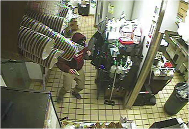 A video still of a suspect in the Jan. 18, 2013 robbery of a Dunkin' Donuts in New Milford. Photo: Contributed Photo
