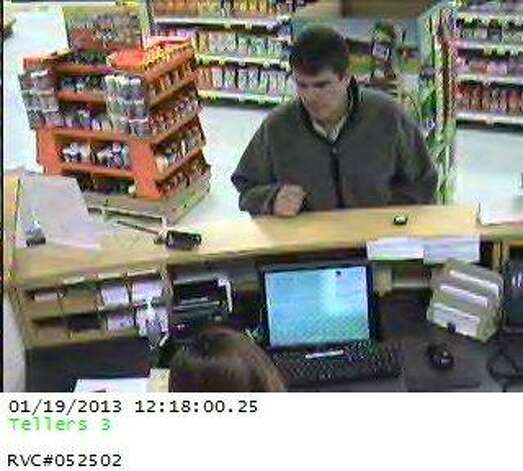 Law enforcement officers say this man robbed Woodforest Bank inside Kroger on Dowlen Road. The man has been caught, and is suspected to be connected to the  robbery of MidSouth Bank in Vidor on Jan. 14. Photo: Courtesy Photo