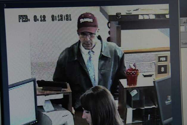 Surveillance footage at Prosperity Bank shows a bank robbery. Photo: Beaumont Police Department