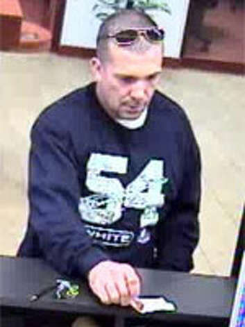 "FBI agents called this bank robber the ""tall, dark and handsome"" bandit. He was later identified to be John Steven Stark, and accused of robbing several banks in Houston and Beaumont. Stark, 46, was arrested in February 2012 and later sentenced to 14 years in prison. Photo: FBI"