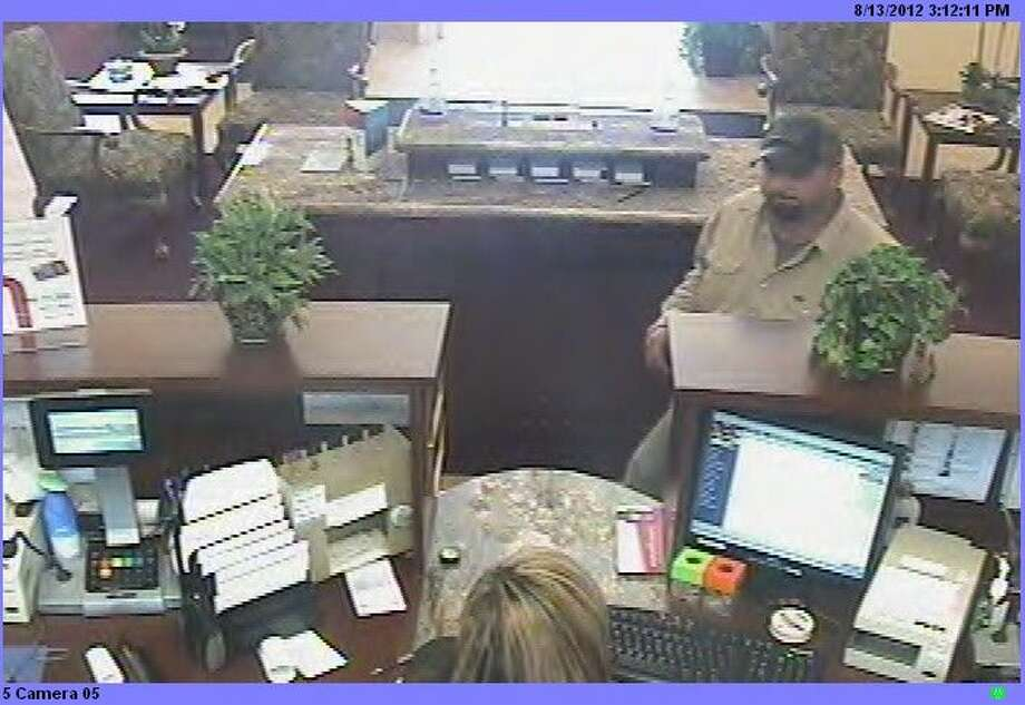 Police said this man was responsible for robbing Community Bank in Nederland on August 13, 2012. Christopher Lee Woodcock, 32, was arrested shortly after the crime and indicted on one charge of bank robbery the following month. Photo: Courtesy