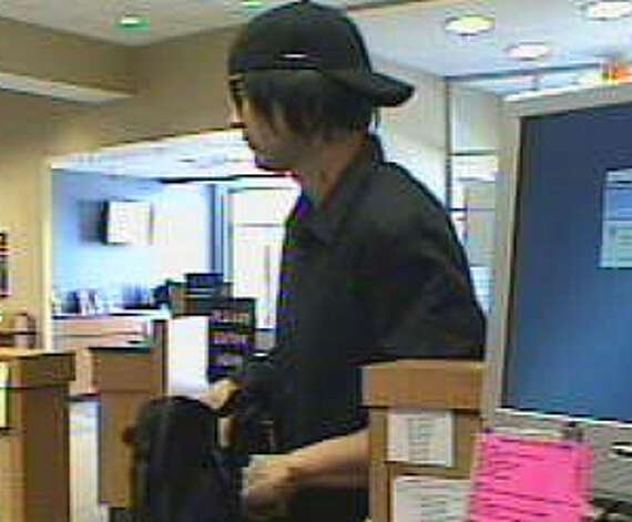 "A suspect in the Oct. 21, 2011 Capital One Bank robbery in Houston has been dubbed the ""passion-marked bandit."" Witnesses believed the man had a  hickey  or a passion mark on the left side of his neck. According to the FBI website, authorities are still searching for him. Photo: FBI"