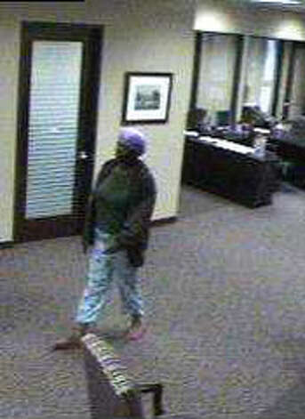 Rub-A-Dub Robber: A suspect in the Oct. 27, 2011 Lonestar Bank robbery in Houston wore a purple shower cap on her head and greenish-yellow pajamas pants with animal or child-like figures on them. The FBI website lists him as still wanted. Photo: FBI