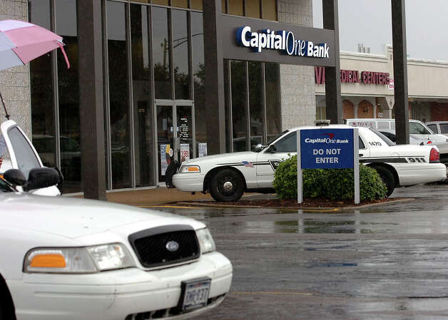 A Beaumont Police are investigating Monday's robbery at the Capital One Bank near the Gateway Shopping Center. Police say the man jumped over the counter, took a night deposit bag then escaped in the passenger side of a pewter truck. Police say the man appeared to be in his late 40's and fled eastbound on College Street. Photo taken Monday, June 18, 2012 Guiseppe Barranco/The Enterprise Photo: Guiseppe Barranco, STAFF PHOTOGRAPHER / The Beaumont Enterprise