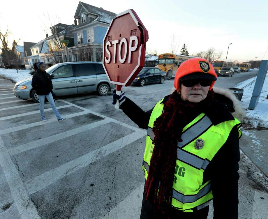 Despite sub zero temperatures School Crossing Officer Carla Rossi mans her post at the intersection of Elbel St. and Whitehall Road Jan. 23, 2013 in Albany, N.Y.  Rossi has been a Crossing Officer for 14 years.  (Skip Dickstein/Times Union) Photo: SKIP DICKSTEIN