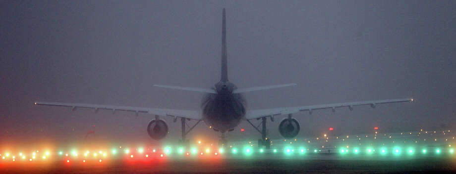 A jet at the San Antonio International Airport prepares for takeoff under foggy conditions Thursday morning January 24, 2013. Thursday should reach a high of 81 degrees and Friday's forecast calls for more foggy conditions. Photo: JOHN DAVENPORT, San Antonio Express-News / ©San Antonio Express-News/ Photo may be sold to the public