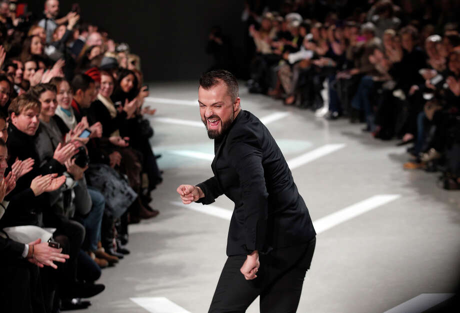 French fashion designer Julien Fournie acknowledges applause after the presentation of  his Spring Summer 2013 Haute Couture fashion collection, in Paris, Tuesday, Jan. 22, 2013. Photo: Christophe Ena, ASSOCIATED PRESS / AP2013