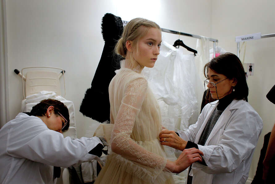A model  is dressed up backstage prior to the Valentino Spring Summer 2013 Haute Couture fashion col