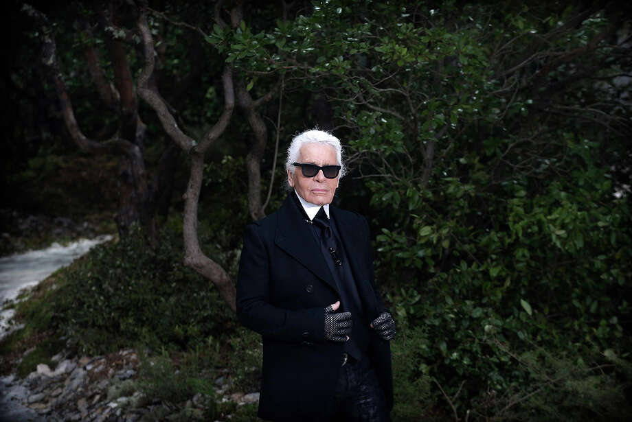 German fashion designer Karl Lagerfeld appears after the presentation of Chanel's Spring Summer 2013 Haute Couture fashion collection, presented in Paris, Tuesday, Jan. 22, 2013. Photo: Christophe Ena, AP / AP2013