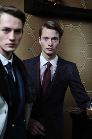 Models pose wearing creations of Smalto's fall-winter 2013/2014 men's fashion collection, in Paris, Saturday, Jan. 19, 2013. Photo: Zacharie Scheurer, ASSOCIATED PRESS / AP2013
