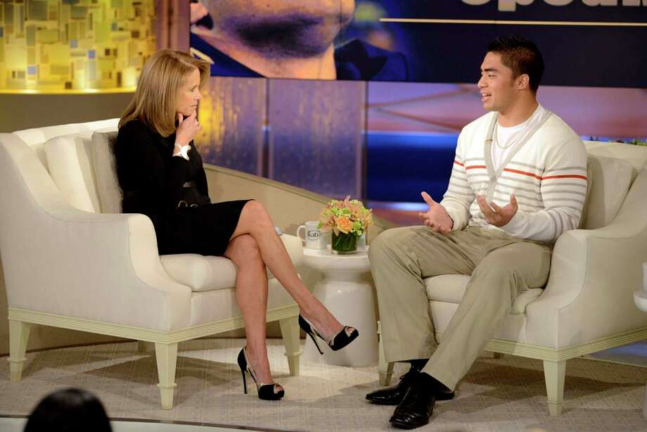 Notre Dame linebacker Manti Te'o, right, speaking with host Katie Couric during an interview for Katie, in New York. Te'o has told Katie Couric that he briefly lied about his online girlfriend after discovering she didn't exist, while maintaining that he had no part in creating the hoax. Pressed by Couric to admit that he was in on the deception, Te'o said he believed that his girlfriend Lennay Kekua had died of cancer and didn't lie about it until December. The interview will air on Thursday, Jan. 24. Photo: Lorenzo Bevilaqua, AP / ©2013 Disney-ABC Domestic Television.  All rights reserved. NO ARCHIVING. NO RESALE.2013