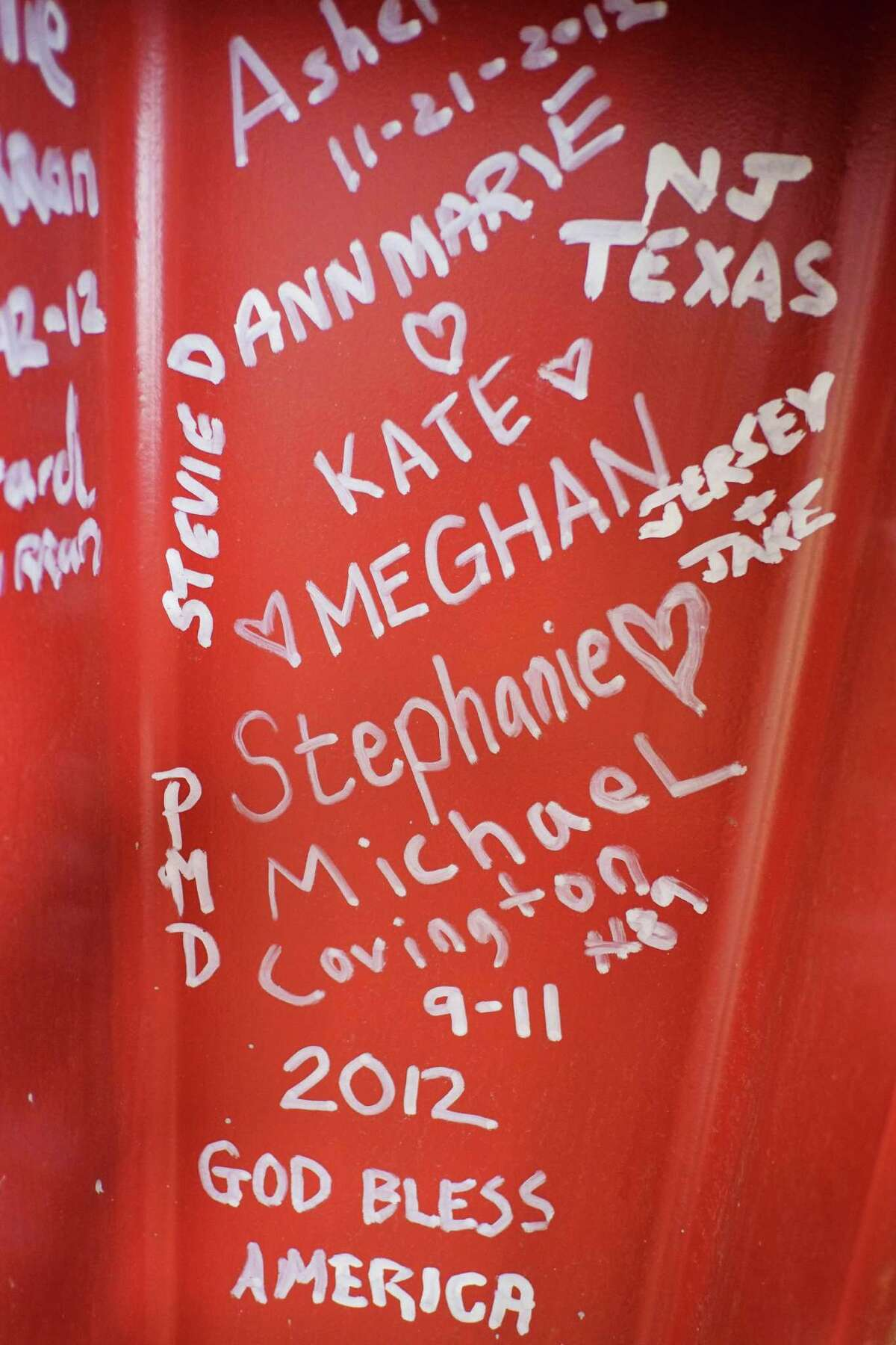 This Jan. 15, 2013 photo shows graffiti left by visitors to the World Trade Center on a steel column on the 104th floor of One World Trade Center in New York. Construction workers finishing New York's tallest building at the World Trade Center are leaving their personal marks on the concrete and steel in the form of graffiti.