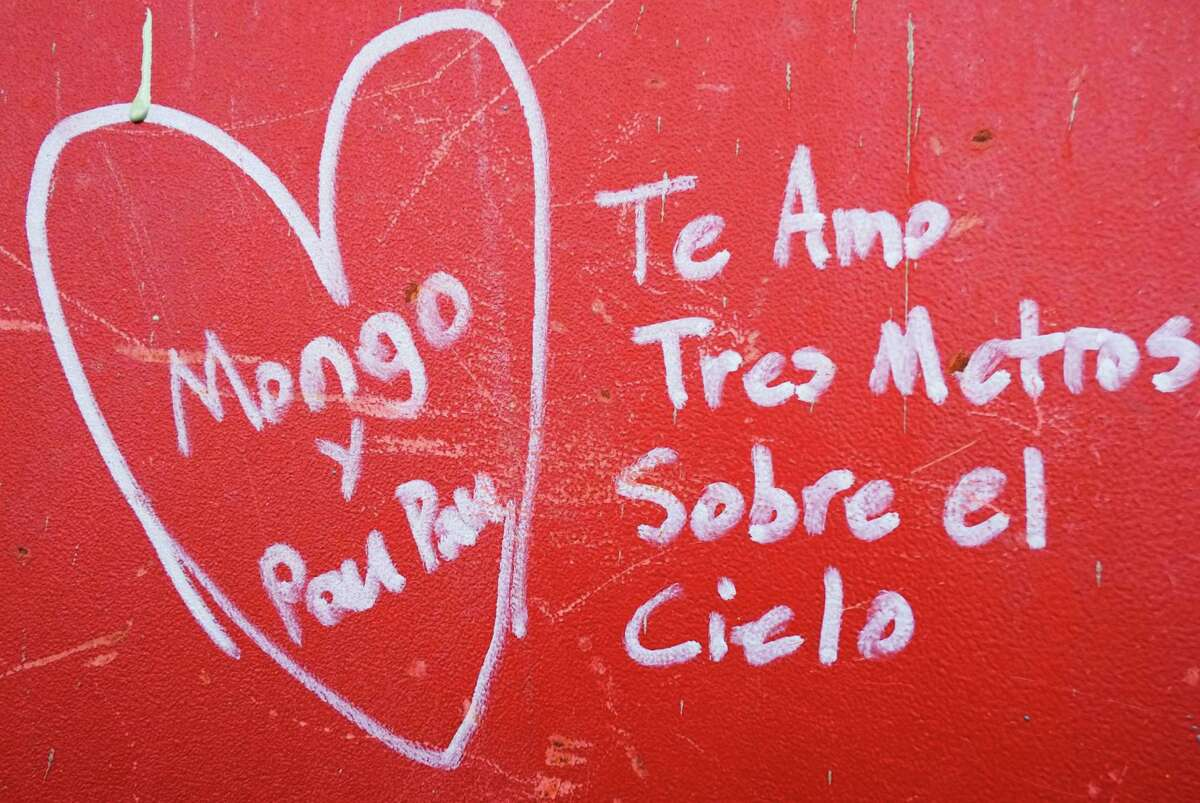 This Jan. 15, 2013 photo shows Spanish graffiti left by a worker on a steel column on the 104th floor of One World Trade Center in New York. Construction workers finishing New York's tallest building at the World Trade Center are leaving their personal marks on the concrete and steel in the form of graffiti.
