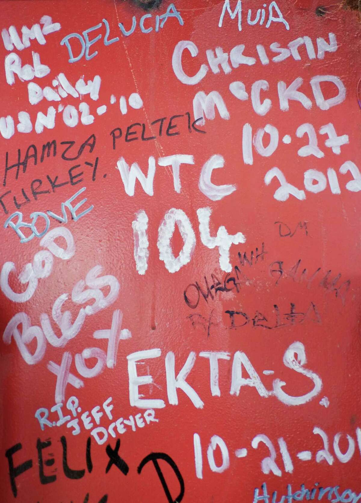 This Jan. 15, 2013 photo shows graffiti left by workers on a steel column on the 104th floor of One World Trade Center in New York. Construction workers finishing New York's tallest building at the World Trade Center are leaving their personal marks on the concrete and steel in the form of graffiti.