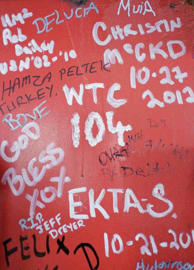 This Jan. 15, 2013 photo shows graffiti left by workers on a steel column on the 104th floor of One World Trade Center in New York. Construction workers finishing New York's tallest building at the World Trade Center are leaving their personal marks on the concrete and steel in the form of graffiti. Photo: Mark Lennihan, AP / AP