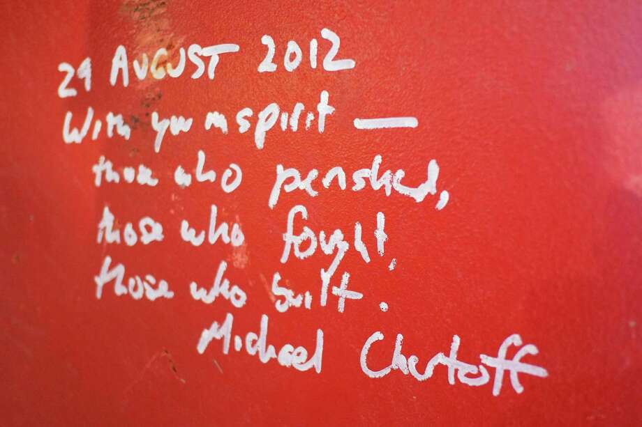 This Jan. 15, 2013 photo shows graffiti left by Michael Chertoff, the former director of Homeland Security, on a steel column on the 104th floor of One World Trade Center in New York. Construction workers finishing New York's tallest building at the World Trade Center are leaving their personal marks on the concrete and steel in the form of graffiti. Photo: Mark Lennihan, AP / AP