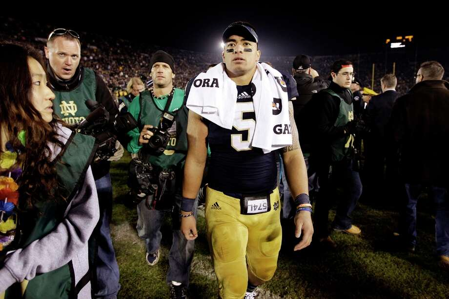 FILE - In this Nov. 17, 2012, file photo, Notre Dame linebacker Manti Te'o walks off the field following an NCAA college football game against Wake Forest in South Bend, Ind. A story that Te'o's girlfriend had died of leukemia _ a loss he said inspired him to help lead the Irish to the BCS championship game _ was dismissed by the university Wednesday, Jan. 16, 2013, as a hoax perpetrated against the linebacker. Photo: Michael Conroy, AP / A2012