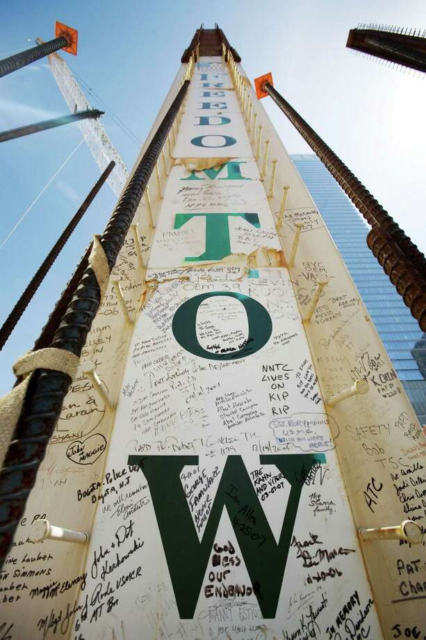 FILE- In this May 30, 2007 file photo, a steel column for the Freedom Tower bears signatures of Sept. 11 victims' family members at the World Trade Center in New York. Their signatures join those left by some who worked on the towers. Construction workers have left personal messages on One World Trade Center in the form of graffiti. Photo: Mark Lennihan, AP / AP