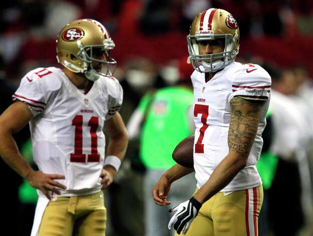 San Francisco 49ers Quarterback Colin Kaepernick (7) and Quarterback Alex Smith (11) before the San Francisco 49ers game against the Atlanta Falcons in the NFC Championship game at the Georgia Dome in Atlanta, GA., on Sunday January 20, 2013. Photo: Brant Ward, The Chronicle / ONLINE_YES