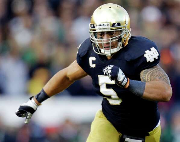 FILE - In this Oct. 20, 2012, file photo, Notre Dame linebacker Manti Te'o chases the action during the second half of an NCAA college football game against BYU in South Bend, Ind. The wrenching story of Te'o's girlfriend dying of leukemia — a loss he said inspired him to play his best all the way to the BCS championship — was dismissed by the school Wednesday, Jan. 16, 2013, as a hoax perpetrated against the linebacker. Photo: Michael Conroy, AP / A20122012
