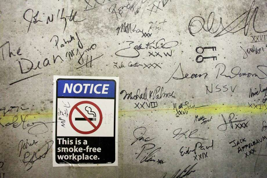 In this Jan. 15, 2013 photo, autographs cover a wall on a top floor of One World Trade Center in New York. Construction workers finishing New York's tallest building at the World Trade Center are leaving their personal marks on the concrete and steel in the form of graffiti. Photo: Mark Lennihan, AP / AP