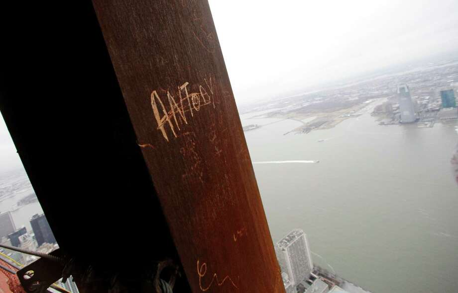 "In this Jan. 15, 2013 photo, Ã'Â""Antony,"" left his graffiti on a steel column on the 102nd floor of One World Trade Center in New York. Workers finishing New York's tallest building at the World Trade Center are leaving their personal marks on the concrete and steel in the form of graffiti. Photo: Mark Lennihan, AP / AP"