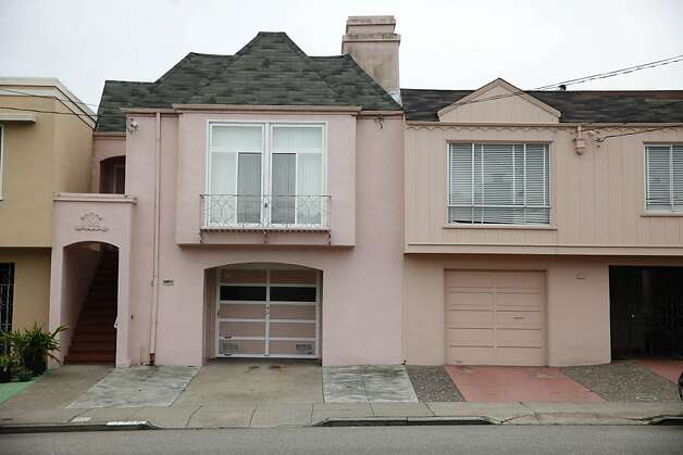 Two homes with their front yards paved over in the Outer Sunset along 30th Avenue. Photo: Lea Suzuki, The Chronicle