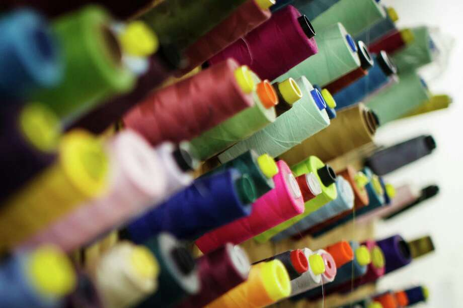 Spools of thread at Greg Fourticq's Moo Boo's, a children's clothing line and manufacturing factory in Houston.  ( Michael Paulsen / Houston Chronicle ) Photo: Michael Paulsen, Staff / © 2012 Houston Chronicle