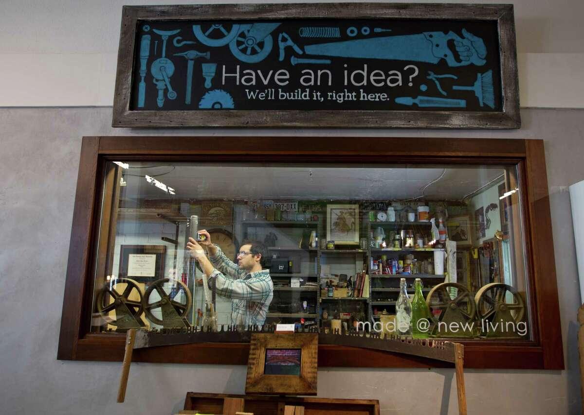 Cooper Meaders, artisan furniture maker, works in his workshop in Made @ New Living, a custom furniture store inside the larger New Living store on Kirby, Thursday, Jan. 17, 2013. ( Karen Warren / Houston Chronicle )