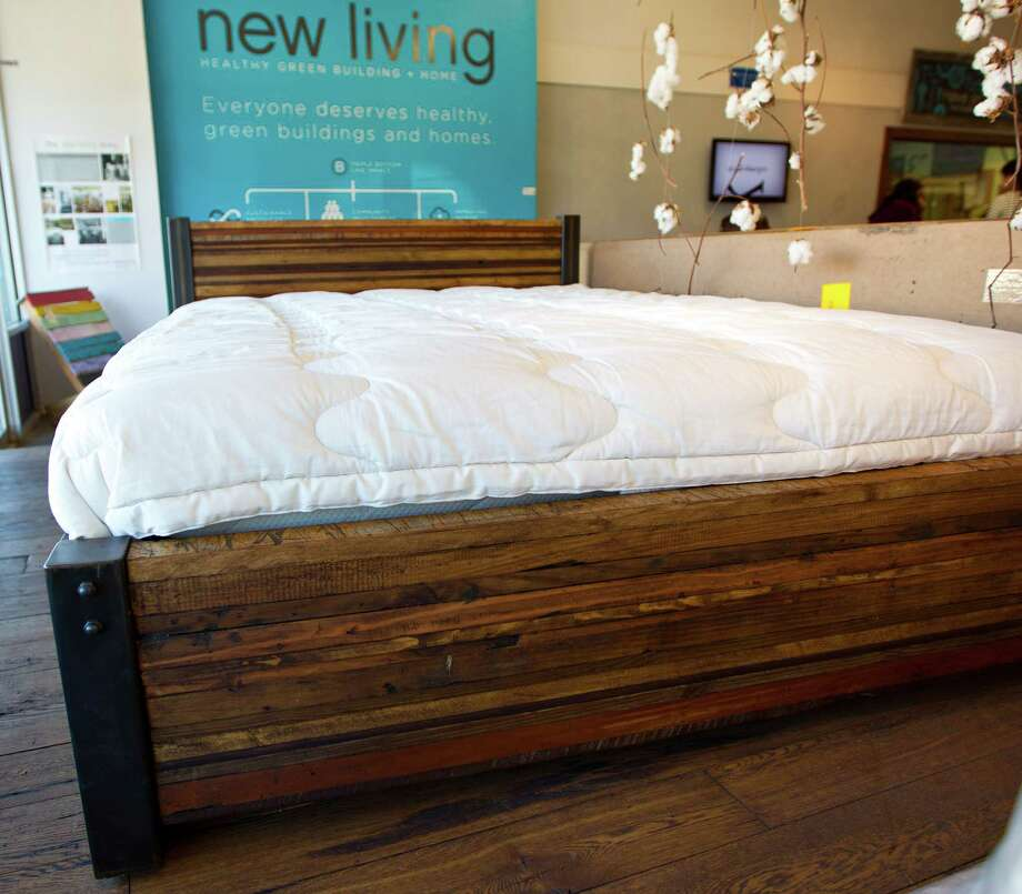 One of the finished furniture pieces made in the workshop in Made @ New Living, a custom furniture store inside the larger New Living store on Kirby, Thursday, Jan. 17, 2013. ( Karen Warren / Houston Chronicle ) Photo: Karen Warren, Staff / © 2013 Houston Chronicle