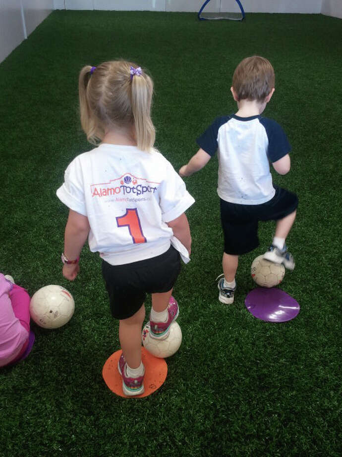 Children at the Alamo TotSports center play Soccer Touch to learn physical coordination. Photo: Courtesy Photo
