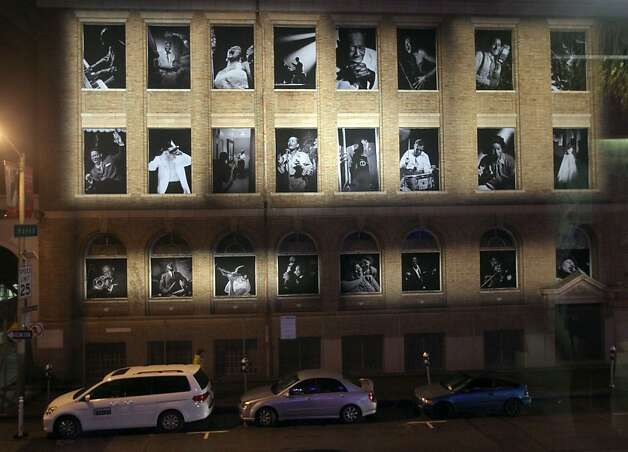 Portraits of Jazz legions are displayed in the windows of an adjacent building across the street from the new SFJAZZ Center Wednesday, Jan. 23, 2013 in San Francisco. Photo: Lance Iversen, The Chronicle