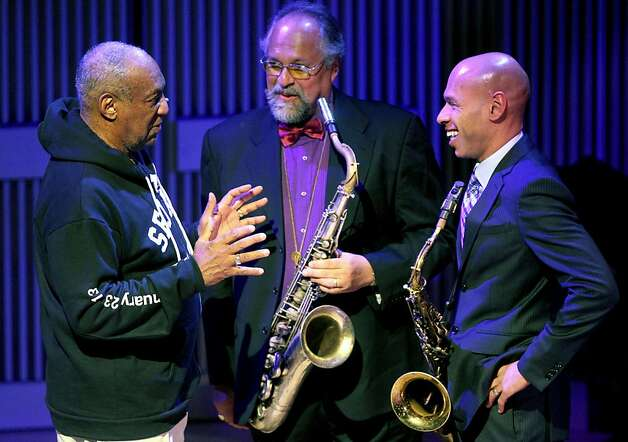 Emcee by Bill Cosby talks with saxophonists players, Joe Lovano, center and Joshua Redman right after they performed during the opening night concert of the SFJAZZ Center Wednesday, Jan. 23, 2013 in San Francisco. Photo: Lance Iversen, The Chronicle