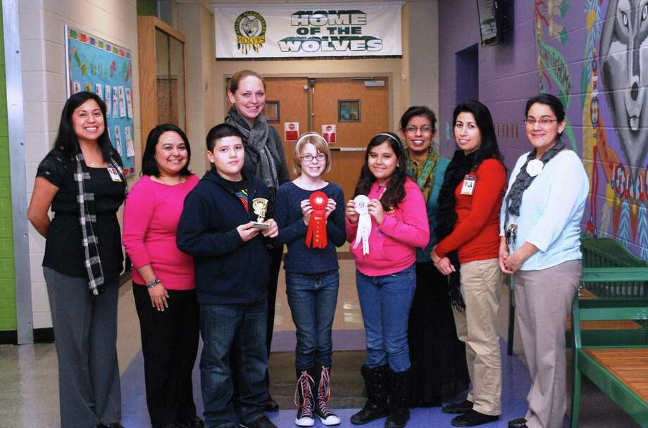 Pictured from the left are Adams Elementary Principal Rita Uresti; Barbara Castillo, Matthew Leos, Jessie Cooper, Riley Ward, Daffne Rodriguez, Eva Vasquez, Alma Guessford and Tai-Nina Castaneda. Photo: Courtesy Photo