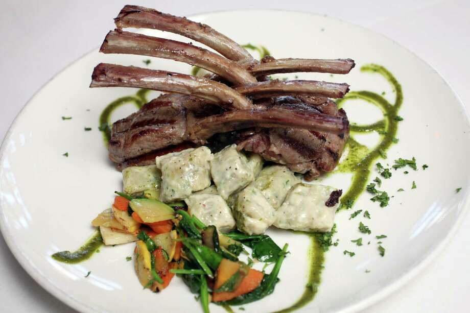 "Calling lamb chops ""scottadito"" refers to them being so good a diner will burn his fingers eating hem fresh off the fire. The Agnello Scottadito dish includes house-made gnocchi ingorgonzola cream and garlicky mixed vegetables. Photo: Juanito M Garza, San Antonio Express-News / San Antonio Express-News"
