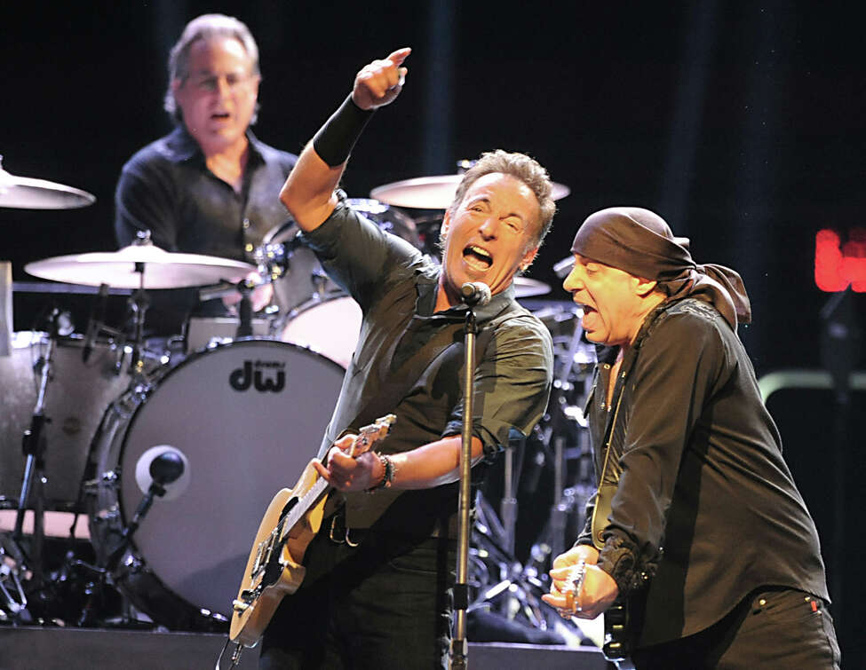 Bruce Springsteen sings with Steve Van Zandt while Max Weinberg plays drums at a sold out performance at the Times Union Center on April 16, 2012, in Albany, N.Y. (Lori Van Buren / Times Union archive)