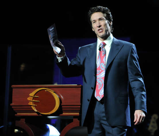 Joel Osteen preaches to a large crowd at the Times Union Center March 16, 2012, in Albany, N.Y. Osteen is a televangelist and the senior pastor of Lakewood Church in Houston. (Lori Van Buren / Times Union archive) Photo: Lori Van Buren / 00016727A