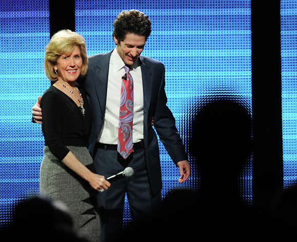 Joel Osteen welcomes his mother, Dodie Osteen, on stage at the Times Union Center March 16, 2012, in Albany, N.Y. Joel Osteen is a televangelist and the senior pastor of Lakewood Church in Houston. (Lori Van Buren / Times Union archive) Photo: Lori Van Buren / 00016727A