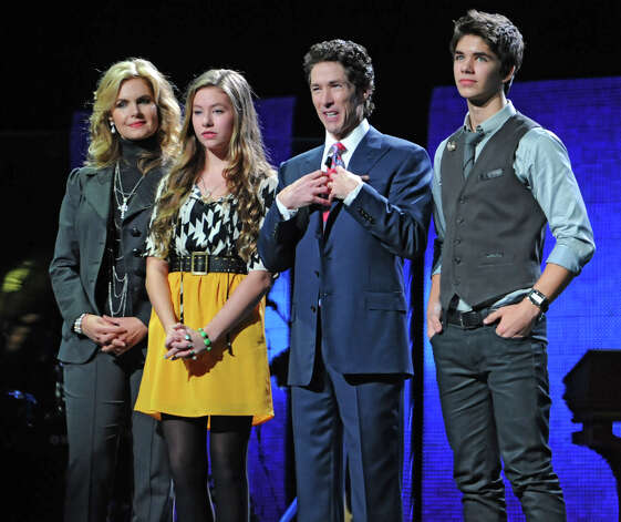 Joel Osteen stands on stage with his wife, Victoria, his daughter Alexanda and son Jonathan in front of a sold-out crowd at the Times Union Center March 16, 2012, in Albany, N.Y. Osteen is a televangelist and the senior pastor of Lakewood Church in Houston. (Lori Van Buren / Times Union archive) Photo: Lori Van Buren / 00016727A