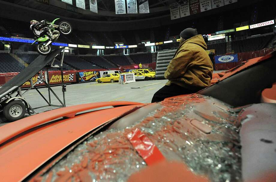 Motorcycle rider Mad Mike Jones practices riding his bike over jumps hours before the opening of The Monster Jam Thunder Nationals monster-truck event being held at the Times Union Center Friday, Jan 20, 2012, in Albany N.Y. (Lori Van Buren / Times Union archive) Photo: Lori Van Buren / 00016150A