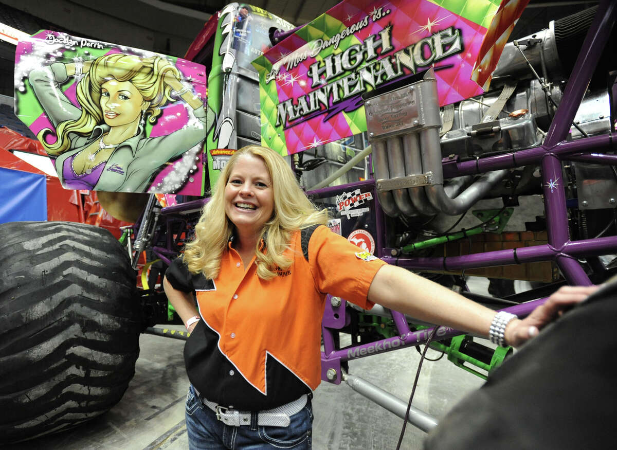 Monster truck driver Jocelyn Perrin poses by her truck hours before the opening of The Monster Jam Thunder Nationals monster-truck event being held at the Times Union Center Friday, Jan 20, 2012 in Albany N.Y. (Lori Van Buren / Times Union archive)